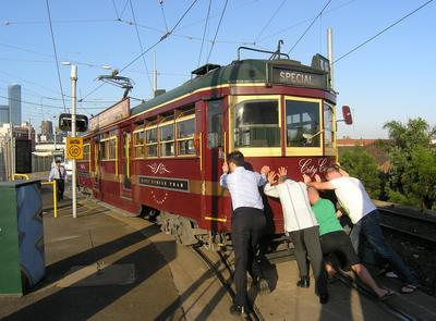 Broken Tram Pushed by Commuters